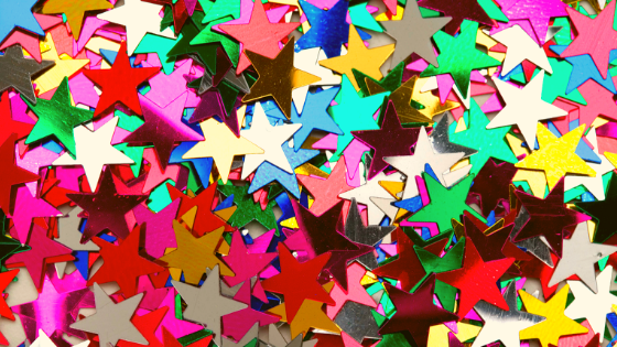A group of colored star confetti